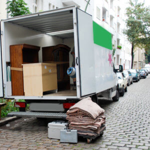 moving van with boxes and furniture